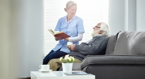 female caregiver with senior man